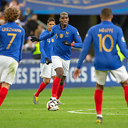 PARIS, FRANCE - March 25:  Paul Pogba #6 of France wached by Antoine Griezmann #7 of France and Kylian Mbappé #10 of France during the France V Iceland, 2020 European Championship Qualifying, Group Stage at  Stade de France on March 25th 2019 in Paris, France (Photo by Tim Clayton/Corbis via Getty Images)