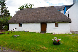 Thatched cottage in village of Plockton, in Lochalsh, Wester Ross area of the Scottish Highlands ,Scotland, UK