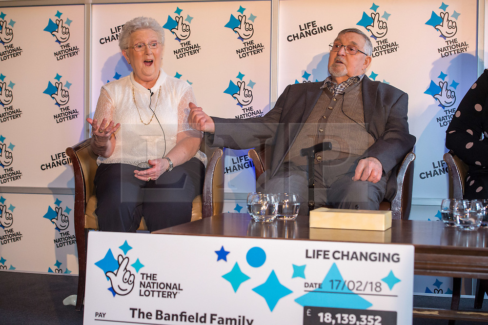 © Licensed to London News Pictures. 20/02/2018. Tortworth Court, Wotton-under-Edge, Gloucestershire, UK. Family of six win £18.1m on Lotto. The BANFIELD family, left-right: mum Shirley age 83, dad Dennis age 87. A family syndicate from Bristol are celebrating after their Lucky Dip ticket matched all six numbers to scoop the £18,139,352 Lotto Jackpot last Saturday. The win, which mum and dad had always told their two daughters was just a matter of time, will mean travel to international sporting fixtures, new cars and a stress-free future for them all. Photo credit: Simon Chapman/LNP