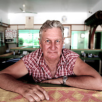 Publican Ron Dewson behind the bar of the Almaden hotel, outback Queensland.