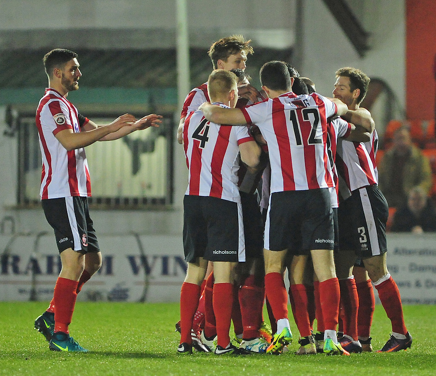 Lincoln City's Sam Habergham celebrates after his cross was deflected in for the first goal off Dover Athletic's Tyrone Sterling<br /> <br /> Photographer Andrew Vaughan/CameraSport<br /> <br /> Vanarama National League - Lincoln City v Dover Athletic - Friday 20th January 2017 - Sincil Bank - Lincoln<br /> <br /> World Copyright © 2017 CameraSport. All rights reserved. 43 Linden Ave. Countesthorpe. Leicester. England. LE8 5PG - Tel: +44 (0) 116 277 4147 - admin@camerasport.com - www.camerasport.com