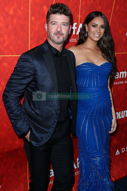 BEVERLY HILLS, LOS ANGELES, CA, USA - OCTOBER 18: amfAR Gala Los Angeles 2018 held at the Wallis Annenberg Center for the Performing Arts on October 18, 2018 in Beverly Hills, Los Angeles, California, United States. 18 Oct 2018 Pictured: Robin Thicke, April Geary. Photo credit: Xavier Collin/Image Press Agency/MEGA TheMegaAgency.com +1 888 505 6342
