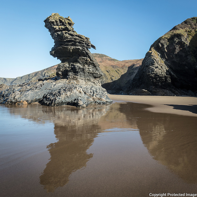 Carreg Bica. According to legend this rock is the tooth of the giant Bica who was forced to spit his tooth onto the beach following a bad toothache. Llangrannog, Ceredigion.
