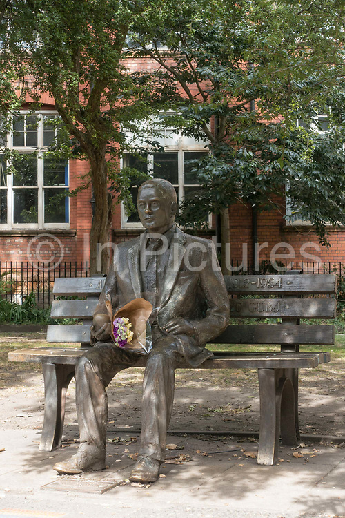 Fresh flowers rest at the Alan Turing Memorial in Sackville Park along Fairfield Street on the 10th August 2018 in Manchester in the United Kingdom. The Alan Turing Memorial, situated in Sackville Park, is in memory of Alan Turing, a pioneer of modern computing.