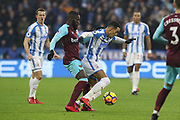 Huddersfield Town's Thomas Ince  is fouled by Arthur Masuaku of West Ham United  during the Premier League match between Huddersfield Town and West Ham United at the John Smiths Stadium, Huddersfield, England on 13 January 2018. Photo by Paul Thompson.