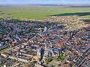 Nederland, Utrecht,  Oudewater, 25-02-2020; Oudewater, kleine stad in het Groene Hart. Riviertje deLange Linschotenmondt uit in rivier deHollandse IJssel. In het centrum onder andere de Waag (heksenwaag), Sint-Franciscuskerk endeGrote of Sint-Michaëlskerk.<br /> Small town in Hollands green heart and rural area.<br /> luchtfoto (toeslag op standard tarieven);<br /> aerial photo (additional fee required)<br /> copyright © 2020 foto/photo Siebe Swar
