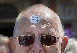 © Licensed to London News Pictures. 20/06/2016. Clacton-on-Sea, UK . A UKIP supporters wears a Vote to Leave sticker on his forehead as party leader Nigel Farage campaigns for Brexit in the last few days of the EU referendum. Photo credit: Peter Macdiarmid/LNP