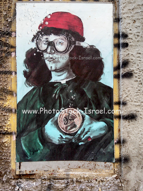 A woman with diving mask. Urban graffiti in Florence