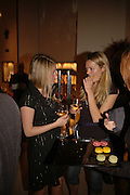 Zoe Cordy Simpson and Lucy Benton-Jones 9 taller) , Champagne reception celebrating 100 years of Chinese cinema  hosted by Hamish McAlpine of Tartan Films, Raising money for Care For Children, a foster care programme in China. Aspreys. New Bond St. London. 25 April 2006. ONE TIME USE ONLY - DO NOT ARCHIVE  © Copyright Photograph by Dafydd Jones 66 Stockwell Park Rd. London SW9 0DA Tel 020 7733 0108 www.dafjones.com