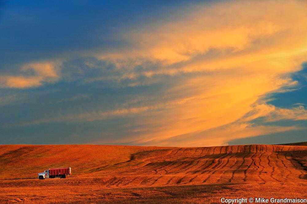 Farm truck and clouds at sunset<br /> Braddock<br /> Saskatchewan<br /> Canada