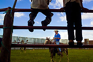 Children watch as local cowboys prepare a annual bullfight in Somotillo, Nicaragua. Bullfighting in Nicaragua is a strange hybrid of bullfighting and bull rodeo. The bull is not killed or injured, just intensely annoyed.