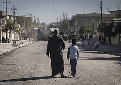 November 20, 2016 - Mosul, Nineveh Governorate, Iraq - Father and his son goes to a food distribution at Mosul. (Credit Image: © Bertalan Feher via ZUMA Wire)