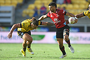 Crusaders Richie Mo'unga fends Hurricanes Peter Umaga-Jensen in the Super Rugby match, Hurricanes v Crusaders, Sky Stadium, Wellington, Sunday, April 11, 2021. Copyright photo: Kerry Marshall / www.photosport.nz