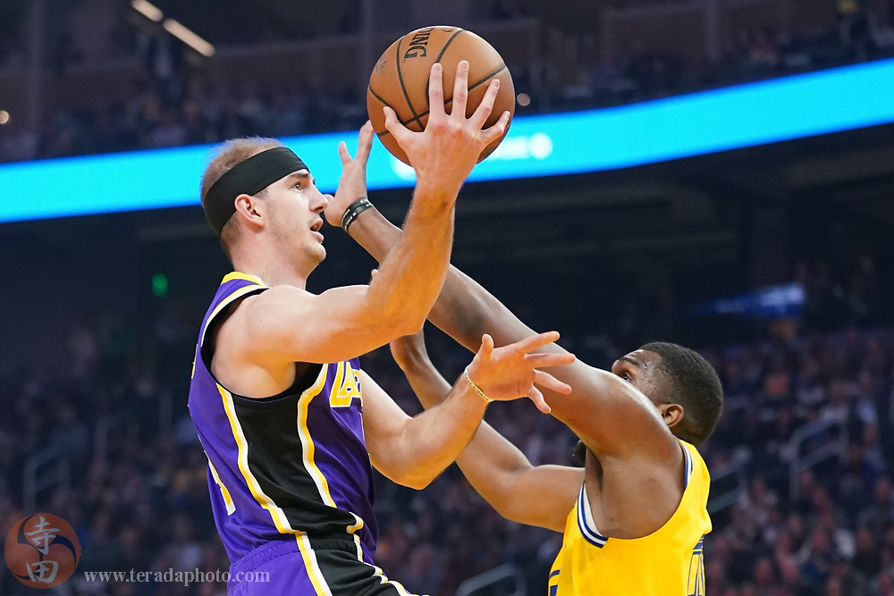 February 27, 2020; San Francisco, California, USA; Los Angeles Lakers guard Alex Caruso (4) shoots the basketball against Golden State Warriors forward Kevon Looney (5) during the first quarter at Chase Center.