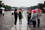 """A group of tourists at """"The Temple of Heaven"""" which is a complex of Taoist buildings situated in the southeastern part of central Beijing. Beijing is the capital of the People's Republic of China and one of the most populous cities in the world with a population of 19,612,368 as of 2010."""