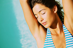 Young Woman Sunbathing, Close-up View