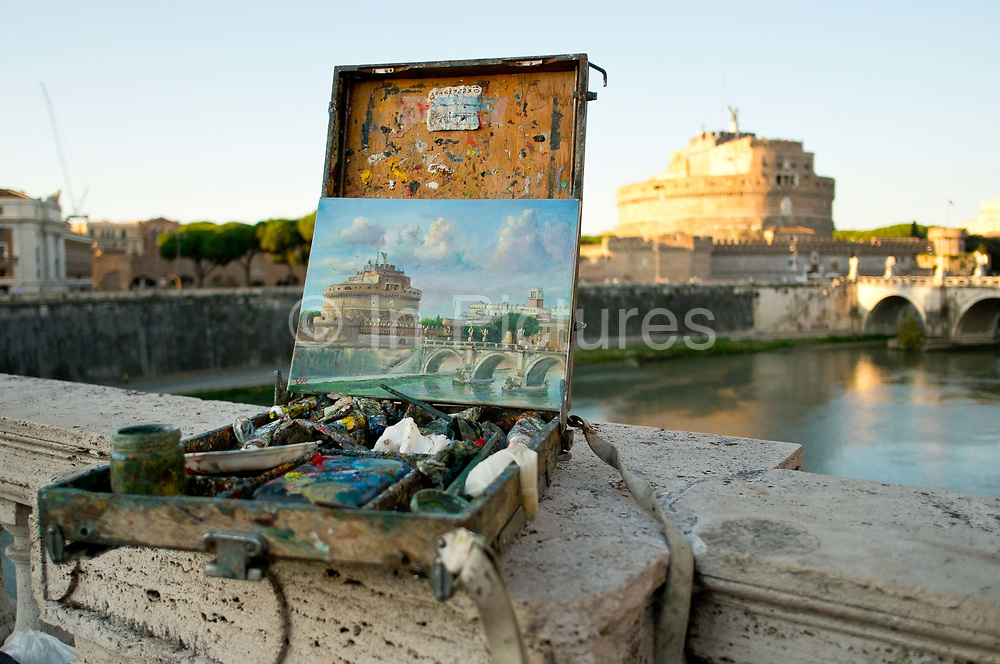 A street painters picture of St Angelo Castle and St Angelo Bridge seen in front of the Castle itself. Rome, Italy.
