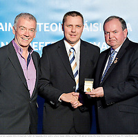 24 November 2012; Referee Rory Hickey, from Clare, is presented with his All-Ireland Senior Football Club Championship referees' medal by Uachtarán Chumann Lúthchleas Gael Liam Ó Néill, right, and Chairman of the National Referees Committee, Pat McEnaney. 2012 National Referees' Awards Banquet, Croke Park, Dublin. Picture credit: Barry Cregg / SPORTSFILE