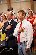 US Senator Rand Paul stands for the pledge of allegiance  at the start of a Republican Party BBQ fundraiser on June 28, 2013 in Columbia, South Carolina. Rand, a Tea Party favorite is planning to run for president in 2016.
