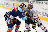 08.Maerz 2012; Rapperswil-Jona; Eishockey NLA - Rapperswil-Jona Lakers - Geneve-Servette HC;<br />  Aurelio Lemm (L, LAK) gegen Jonathan Mercier (R, GENF) (Thomas Oswald)