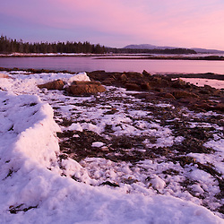 The icy shoreline at Wonderland  in Maine's Acadia National Park. Sunrise.