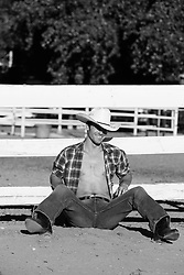 hot young cowboy with an open shirt on a ranch