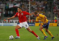 Photo: Glyn Thomas.<br /> Sweden v England. FIFA World Cup 2006. 20/06/2006.<br /> <br /> England's Frank Lampard (L) is pursued by Mattias Jonson.