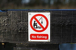 No Fishing sign on the Grand Union Canal near Market Harborough, Leicestershire, England, UK.