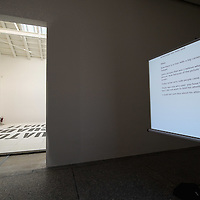 """VENICE, ITALY - MAY 31:  Artist Dora Garcia performs on her  project  """"The Inadequate"""" typiing a note mentioning Getty on a screen at the Spanish pavillion at the Giardini Biennale on May 31, 2011 in Venice, Italy. This year's Biennale, the 54th edition, will  officially open  on Saturday June 4th, after several days of press previews, and will run until 27 November"""