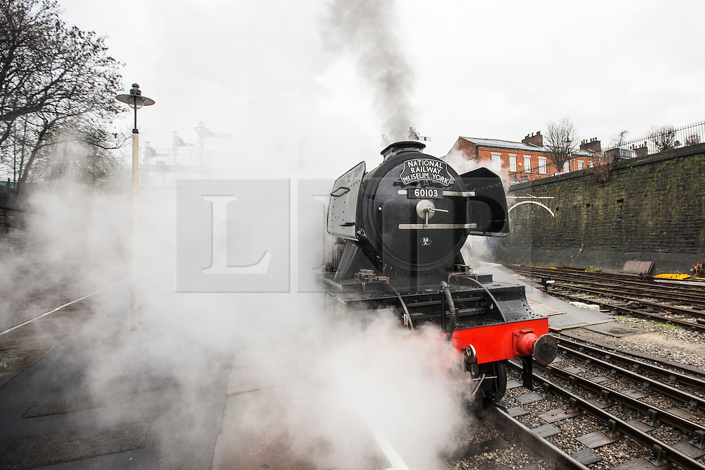 © Licensed to London News Pictures. 08/01/2016. Bury UK. The Flying Scotsman has made is first test run this morning flowing a £4.2m restoration. The engine made a short trip from the shed were restoration work has been carried out to Bury Bolton Street station.Photo credit: Andrew McCaren/LNP