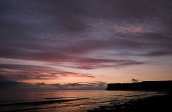 © Licensed to London News Pictures. <br /> 18/08/2016. <br /> Satburn-By-The-Sea, UK.  <br /> <br /> The first light of day reaches over cliffs at Saltburn-By-The-Sea.<br /> <br /> Photo credit: Ian Forsyth/LNP