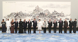 (170904) -- XIAMEN, Sept. 4, 2017 (Xinhua) -- Chinese President Xi Jinping and his wife Peng Liyuan pose for a group photo with leaders attending the ninth BRICS summit and the Dialogue of Emerging Market and Developing Countries and their spouses before a banquet in Xiamen, southeast China's Fujian Province, Sept. 4, 2017. (Xinhua/Ma Zhancheng) (mcg) (Photo by Xinhua/Sipa USA)