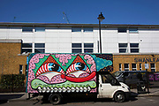 Delivery van painted with a street art mural by Malarkey and Sweet Toof in London, England, United Kingdom.