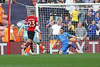 Football - 2018 / 2019 Premier League - Southampton vs. Chelsea<br /> <br /> Alvaro Morata of Chelsea slots the ball past Southampton's Alex McCarthy to make it three at St Mary's Stadium Southampton<br /> <br /> COLORSPORT/SHAUN BOGGUST
