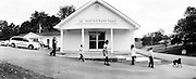 GLASGOW, KY – SEPTEMBER, 2009: Children play outside South Fork Baptist Church following a Sunday morning service.