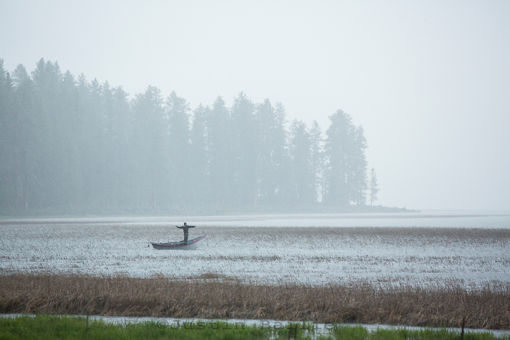 Fly fishing during a thunderstorm on Davis Lake in central Oregon.