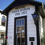"""The historical Police Station in the main street of Petone...Petone is a major suburb of the city of Lower Hutt in New Zealand. It is located at the southern end of the narrow triangular plain of the Hutt River, on the northern shore of Wellington Harbour. The name, from the Maori Pito-one, means """"end of the beach"""" or """"short beach""""...Petone was the first European settlement in the Wellington region and retains many historical buildings and landmarks. The first settlers arrived here in January 1840, on the ship Aurora. After the arrival of a second ship, the Cuba, plans were undertaken for the building of the settlement of Britannia on the site. As it sits in what was once the swamp, the earliest settlers found life hard, and new settlement was abandoned after only a few months. A new site was chosen around the shores of what is now the city of Wellington, New Zealand's capital.  24th January 2011. Photo Tim Clayton."""