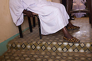 Status-symbol Leopard-skin slippers adorn the feet of an official of the 4 sq km Abu Shouk refugee camp, which is (disputedly) home to 38,000 displaced persons, on the outskirts of Al Fasher, North Darfur, Sudan.