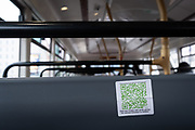 On the back of a bus seat, a discreet sticker shows a QR Code which advertises an illegal party,  during the Coronavirus pandemic, a time when the government and police are having to shut-down social gatherings where distances are being ignored, on 29th August 2020, in London, England,