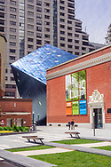 Couple walking, Contemporary Jewish Museum, designed by Daniel Libeskind designed square foot museum, extends the 1907 Jesse Street Power Substation, originally designed by Willis Polk,Contemporary Jewish Museum was founded in 1984 in San Francisco, California