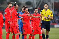 Barcelona´s Pique, Busquets, Xavi and Messi argue with the referee during 2014-15 La Liga match at Coliseum Alfonso Perez stadium in Madrid, Spain. December 13, 2014. (ALTERPHOTOS/Victor Blanco)