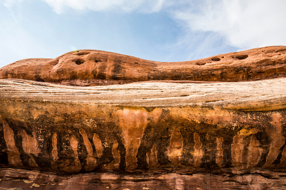 Water streaks on a sandstone rock formation. Needles District, Canyonlands National Park, Utah, USA.
