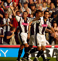 Photo: Leigh Quinnell.<br /> West Bromwich Albion v Arsenal. The Barclays Premiership.<br /> 15/10/2005. Geoff Horsfield cheers with the fans after Darren Carters goal(right)