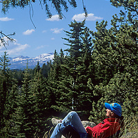 A hiker rests at a scenic overlook in Wyoming's Beartooth Mountains.