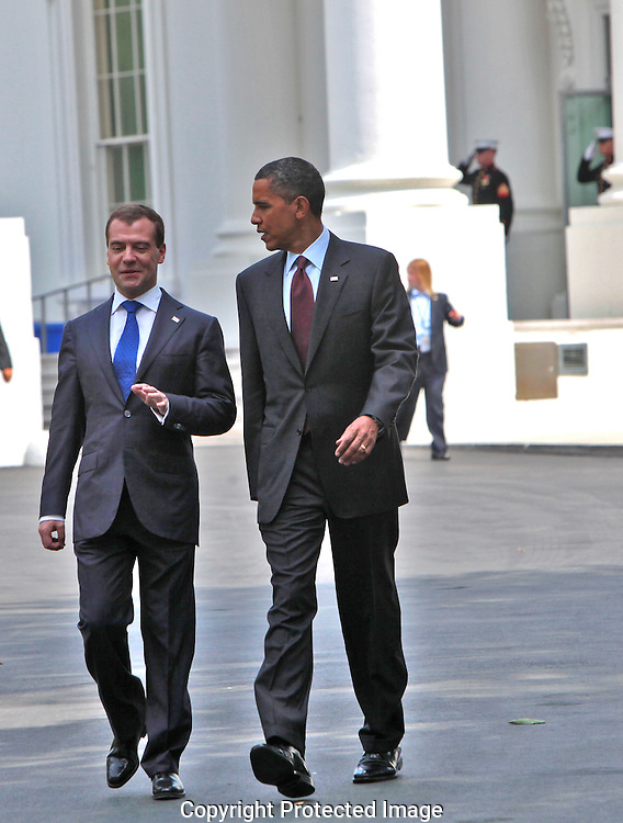 President Barack Obama and President Dmitry Medvedev of Russia take a walk with the North Portico of the White House in the background.  They are walking to the US Chamber of Commerce after at a joint statement and press conference in the East Room of the White House on June 24, 2010.  Photo by Dennis Brack