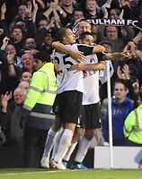 Scorer of the third Clint Dempsey celebrates with bobby Zamora<br /> F.A. Barclays Premiership. Fulham v Liverpool. 31.10.09<br /> Photo By Karl Winter Fotosports International