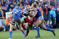 Hull Kr's Jimmy Keinhorst is tackled by Wakefield Trinity's Bill Tupou during the Betfred Super League match at Belle Vue, Wakefield.