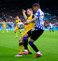 Lincoln City's Chris Maguire vies for possession with Sheffield Wednesday's Marvin Johnson<br /> <br /> Photographer Andrew Vaughan/CameraSport<br /> <br /> The EFL Sky Bet League One - Sheffield Wednesday v Lincoln City - Saturday 23rd October 2021 - Hillsborough Stadium - Sheffield<br /> <br /> World Copyright © 2021 CameraSport. All rights reserved. 43 Linden Ave. Countesthorpe. Leicester. England. LE8 5PG - Tel: +44 (0) 116 277 4147 - admin@camerasport.com - www.camerasport.com