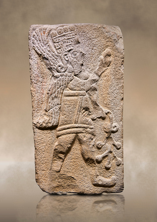 Aslantepe Hittite relief sculpted orthostat stone panel. Limestone, Aslantepe Malatya, 1200-700 B.C. Anatolian Civilisations Museum, Ankara, Turkey.<br /> <br /> Winged protective god holds a branch with fruits. in his left hand, and a fruit in his right hand.<br /> <br /> Against a brown art background.<br /> <br /> If you prefer to buy from our ALAMY STOCK LIBRARY page at https://www.alamy.com/portfolio/paul-williams-funkystock/hittite-art-antiquities.html . Type - Aslantepe - in LOWER SEARCH WITHIN GALLERY box. Refine search by adding background colour, place, museum etc.<br /> <br /> Visit our HITTITE PHOTO COLLECTIONS for more photos to download or buy as wall art prints https://funkystock.photoshelter.com/gallery-collection/The-Hittites-Art-Artefacts-Antiquities-Historic-Sites-Pictures-Images-of/C0000NUBSMhSc3Oo