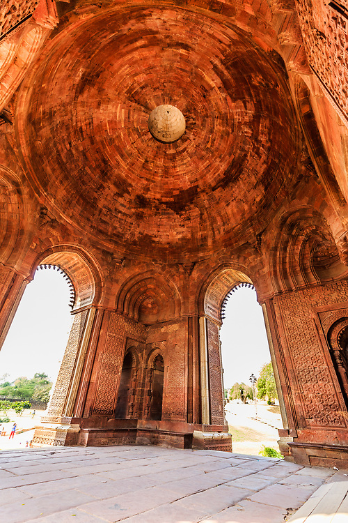 Interior of Alai Darwaza, resembling timber ornamentation in Qutb Minar Complex in Delhi, India. The Alai Darwaza is a perfect specimen of architecture belonging to the period of the Delhi Sultanate. The main structure of the Alai Darwaza consists of a single hall 10,5 m (34½ feet) on the inside and 17,2 m (56½ feet) on the outside. The domed ceiling rises to a height of 14,3 m (47 feet).